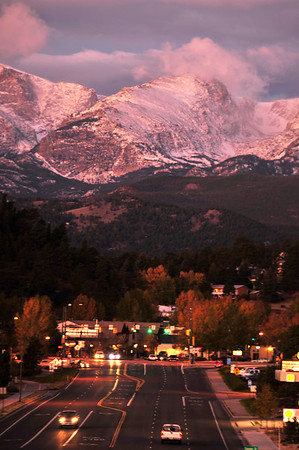 Walt Hester | Trail Gazette<br /> Later sunrise and new snow create a different light during the morning drive into Estes Park on Monday.