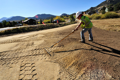 Walt Hester   Trail Gazette Trudy Pillow of Kearney and Sons Excavating smoothes dirt at the corner of Fish Creek and Scott Avenue on Wednesday. The area will soon have an extension of the running and biking trail.