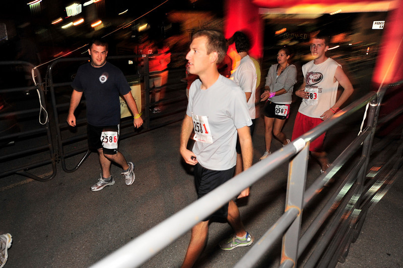 Walt Hester | Trail-Gazette<br /> Another team crosses the finish line in the Hay Market in downtown Lincoln at 8 p.m. on Saturday, some 14 hours after leaving Omaha.