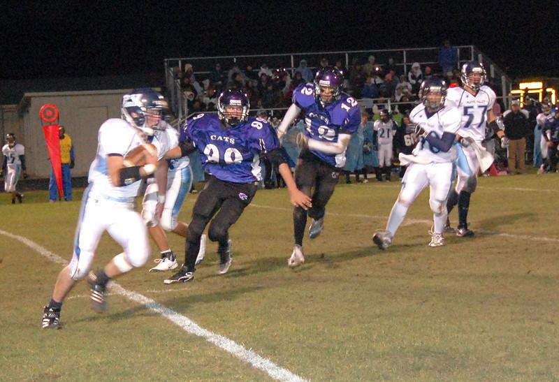 Bobcat defenders pursue the Platte Valley quarterback during second quarter action of the Oct. 8 contest in Estes Park.