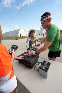 Walt Hester   Trail-Gazette Runners exchange and check in at the Springfield Rodeo Grounds. Teams were given a timing chip to track their time and progress. Teams were required to average under ten minutes per mile by exchange 19, or they would be pulled from the course.