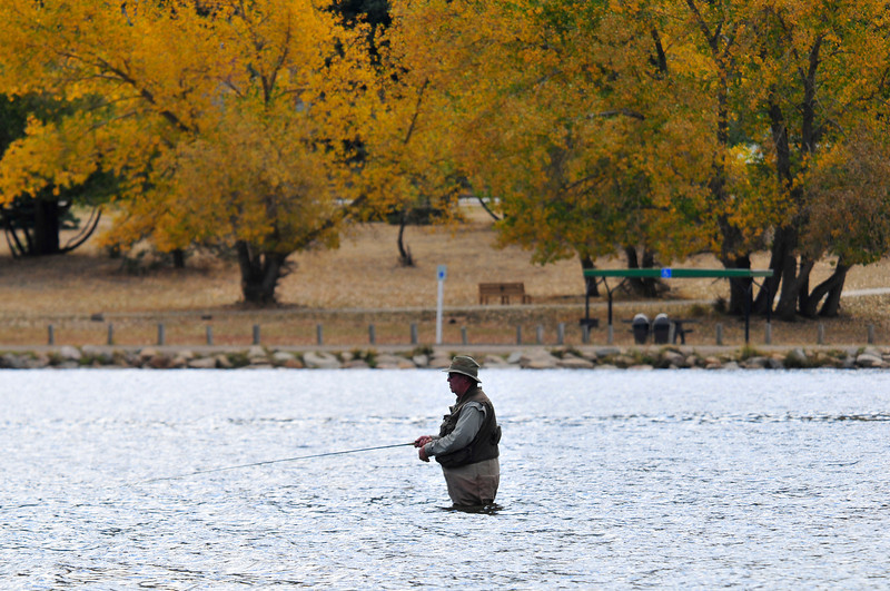 Walt Hester | Trail-Gazette<br /> A fisherman stands in the shallows of Lake Estes on Thursday. The shallow sections of the lake lend themselves to flyfishing.