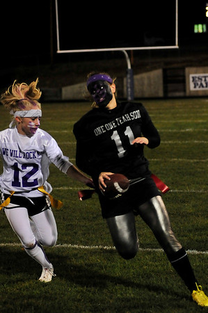 Walt Hester | Trail-Gazette<br /> Kyra Stark leads the Raider-esque seniors down the field on Wednesday. The seniors decorated their faces with black face paint and purple handprints.