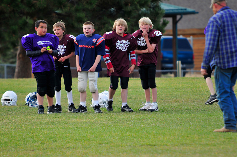 Walt Hester | Trail-Gazette<br /> The boys of the Estes Park Elementary School football program await the next drill at practice on Thursday.