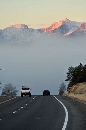 Walt Hester | Trail-Gazette<br /> Commuters drive through a thick bank of fog to get downtown on Wednesday. With chillier temperatures, fog has formed around the waterways of Estes Park.