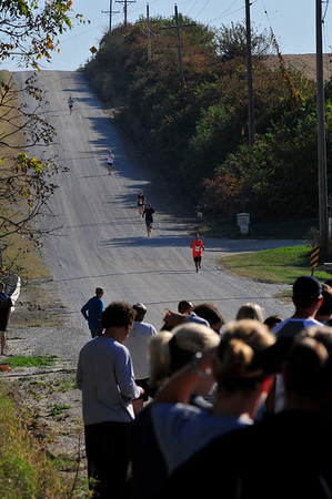 Walt Hester | Trail-Gazette<br /> Little-known fact; the farmland east of Lincoln, Nebraska is not that flat. Runners descend one of the rolling rural roads on Saturday.