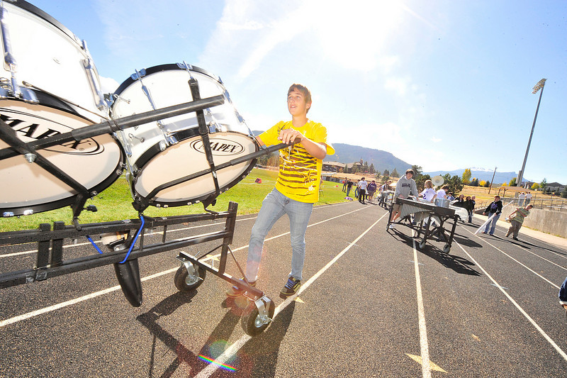Walt Hester   Trail-Gazette<br /> Members of the Estes Park Marching Band pack in their instruments after practice on Wednesday. The band will present their competition program at halftime of Friday's Homecoming game.