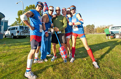 Tim Woodbury   Special for Trail-Gazette The author poses with the runners of Advanced Chiroprctic at the stage 6 exchange point south of Bellevue, Nebr. Some had speed, others had style as the American Gladiators stated they were in it for the costume contest.