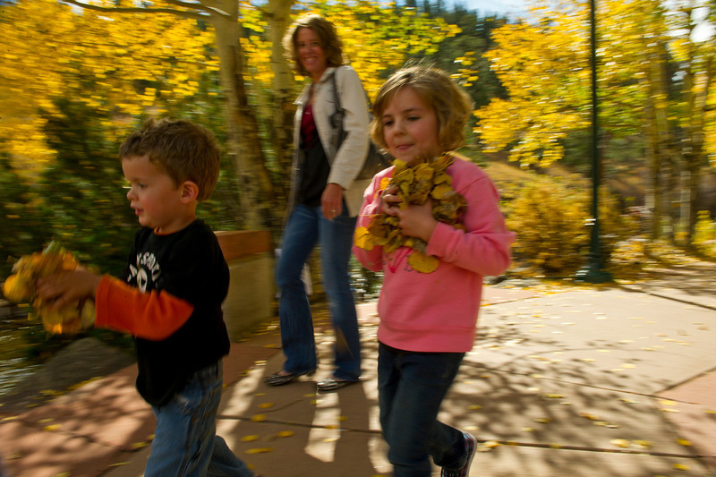 Walt Hester | Trail Gazette<br /> Ashton Dungan, 3, and Ashlee Moore, 5, gather leaves for tossing along the Big Thompson River on Sunday.