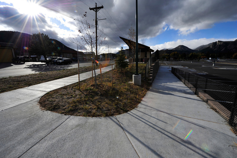 Walt Hester | Trail Gazette<br /> Stormy clouds blow over Estes Park and the Stanley Park Transportation Hub on Monday. The bus stop's wheelchair ramp may need replacing to comply with the Americans with Disabilities Act.