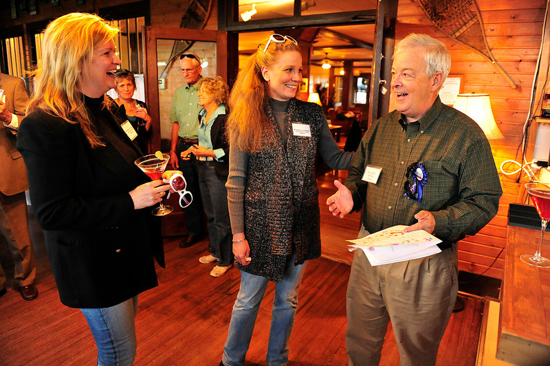 Walt Hester | Trail Gazette<br /> Dr. Rick Beesley, right, is happy and surprised with well-wishers at the Crags on Friday. The event was a party to honor the pedeatrician's retirement from the Family Medical Clinic.