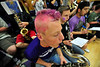 Walt Hester | Trail Gazette<br /> Musician and Estes Park senior Cain Bratrud sports pink hair at Tuesday's Ladycats volleyball game. This week, many of the high school's sports teams are donning pink in recognition of Breast Cancer Awareness Month.