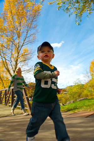 Walt Hester | Trail Gazette<br /> Gunnison Berg, 2, of Estes Park races around with his Packers jersey along the RIver Walk on Sunday.