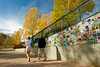 Walt Hester | Trail Gazette<br /> A couple walks by and enjoys the art and foliage along the Riverwalk between the Big Thompson River and East Elkhorn Avenue on Sunday.