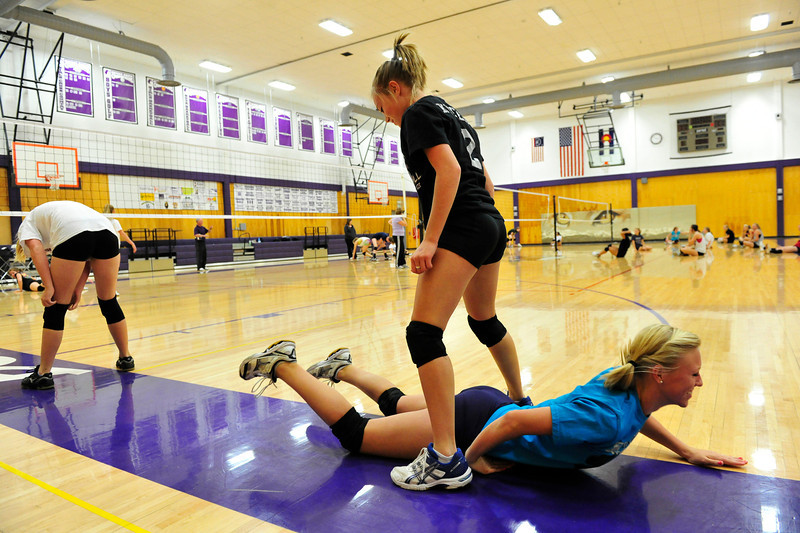 Walt Hester | Trail Gazette<br /> Estes Park Ladycats' volleyball have a little fun with their warm up on Monday. The girls made a game of warming up with a race of leap-frog, blocking jumps at the net, then diving and sliding under their team mates.