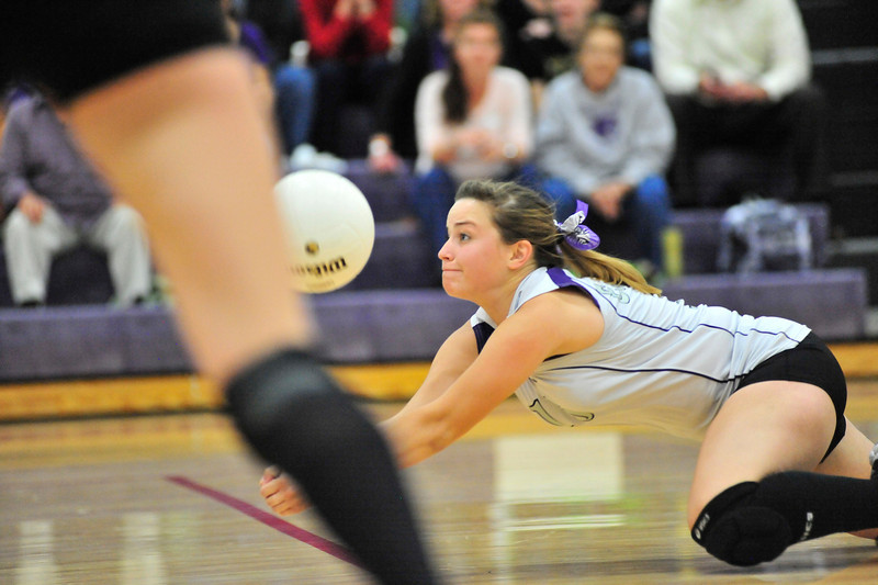 Walt Hester | Trail Gazette<br /> Senior Audrey Ault dives for a ball aginst Strasburg on Tuesday. The Ladycats put together a solid win in game one, only to lose the next three, and the match.