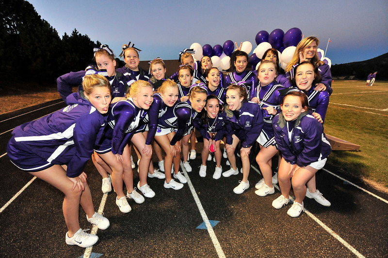 Walt Hester | Trail-Gazette<br /> Estes Park High School Cheerleaders make faces for fans before the Homecoming game on Friday.