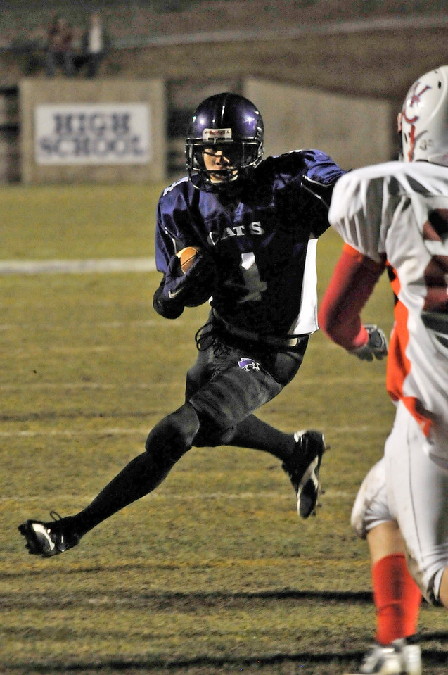 Walt Hester | Trail-Gazette<br /> Estes Park's Kent White looks for room against the Weld Central Defense. The Bobcats' running game showed a spark against the Rebels on Friday, but couldn't quite keep burning.