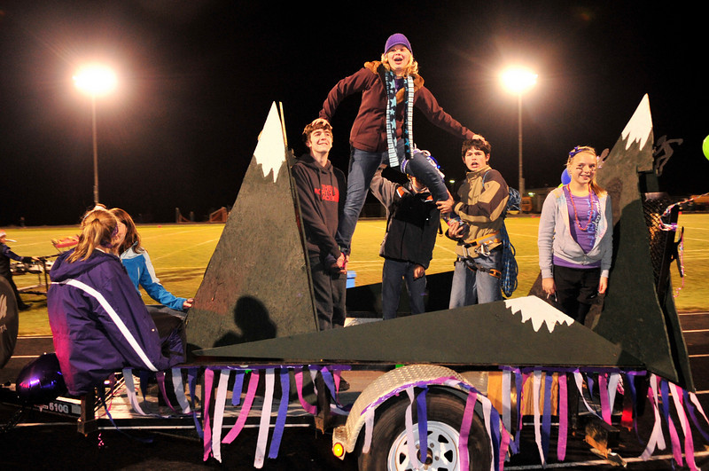 Walt Hester   Trail-Gazette<br /> members of the Estes Park Climbing Team ride around Bobcat Stadium on their homecoming float before the choice awarding of the best float trophy on Friday. The freshman class float won the award this year.