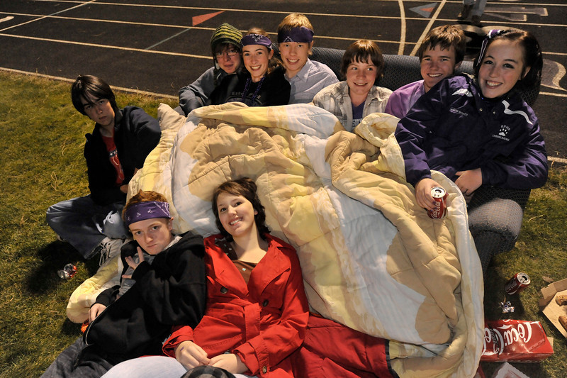 Walt Hester | Trail-Gazette<br /> Winners of the Spirit Couch enjoy a sideline view of Friday's Homecoming football game. The pictured winners are, from lower left,  Luke Miller, Amber Lorenz, Jared Burton, Adrian Smith, Sierra Dennis, Luke Holmes, A.J. Schwarz, Noah Purdy and Grace Moreau.