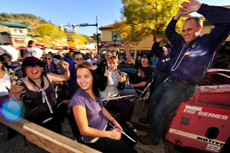 Walt Hester | Trail-Gazette<br /> The Estes Park High School Band carries the school's principal, Jeff Lund, During Friday's Homecoming Parade on Elkhorn Avenue. The parade, the shortest of the annual parades, makes up for it's size with enthusiasm.