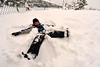 Walt Hester | Trail Gazette<br /> Zach Johnson of Estes Park takes time from his sledding to make snow angles near the Estes Park Elementary School on Wednesday. Classes were cancelled for Park R3 schools due to Wednesday's snow storm.