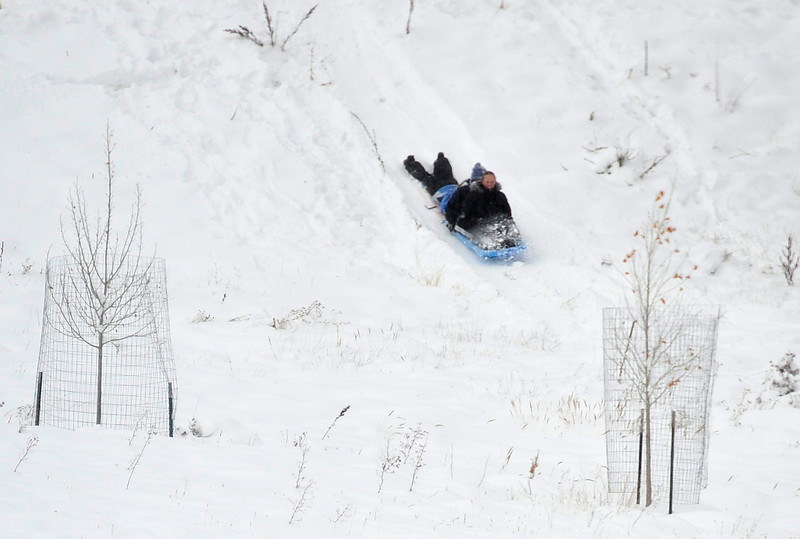 Walt Hester | Trail Gazette<br /> Sledders slid down an embankment along Hwy 7 on Wednesday. The 14-16 inches of new snow gave winter play enthusiasts plenty to enjoy.