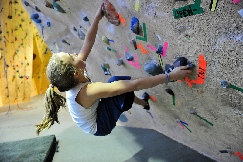 Walt Hester | Trail Gazette<br /> Ivy Todd scopes out her next move while bouldering at the Estes Park Mountain Shop's climbing wall om Wednesday.
