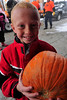 Walt Hester | Trail Gazette<br /> Aidan Donaldson, 6, smiles and heads back to class after receiving his pumpkin at the Elementary School on Thursday. The Rotary Club of Estes Park, with the help of Safeway, distributed pumpkins at the school, as they have for many years.