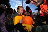 Walt Hester | Trail Gazette<br /> Evie Gittings, 4, receives her pumpkin from the Estes Park Rotary Club on Thursday. The event has taken place for more than 20 years in Estes Park.