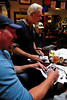 Walt Hester | Trail Gazette<br /> Former Broncos Ralph Tamm, Jim Jensen and Dave Studdard sign autographs and enjoy Sunday's game at the Wheel Bar. The players regularly donate their time to promote charitable events in Colorado.