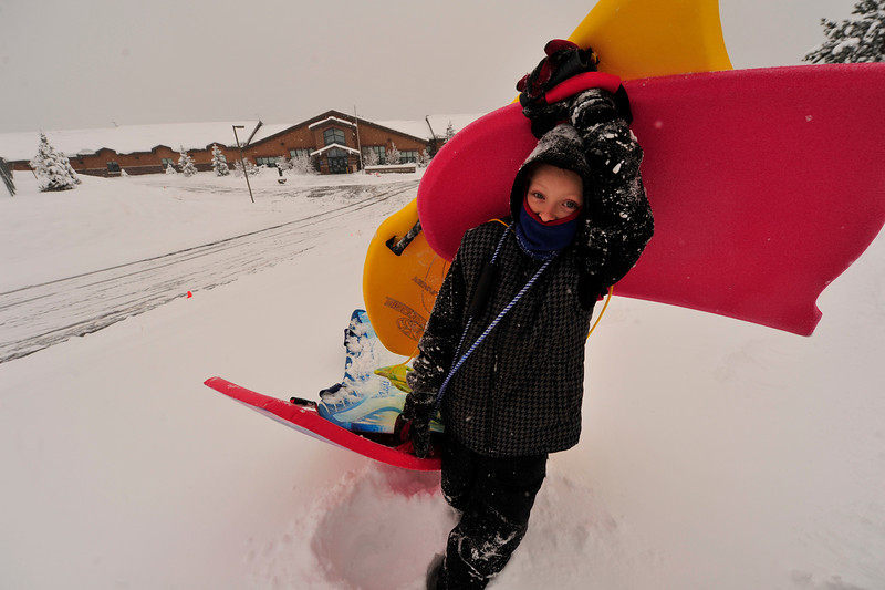 Walt Hester | Trail Gazette<br /> Andrew Johnson, 10, drags a collection of sleds past the empty Estes Park Elementary School on Wednesday morning. Parents received calls early on Wednesday informing them of the weather-related school closure.