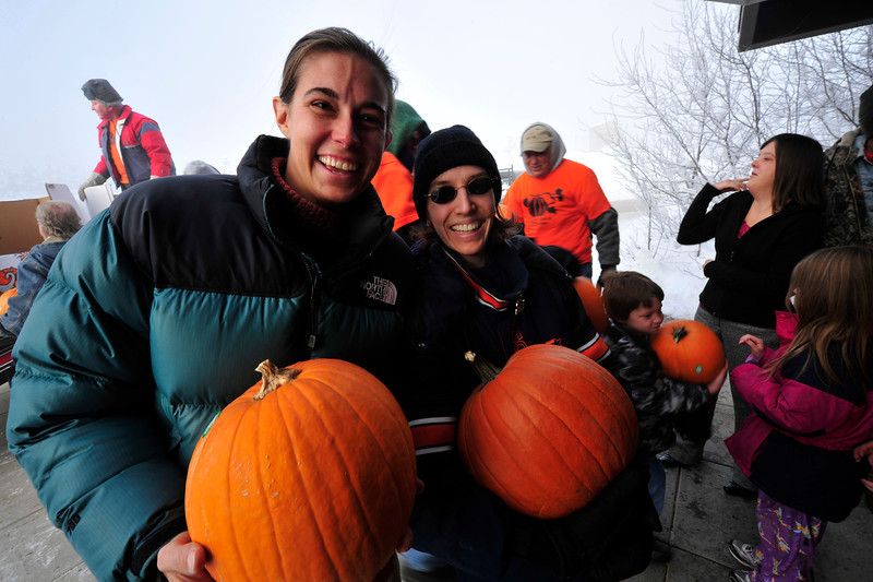Walt Hester | Trail Gazette<br /> Erin Axtell and Jena Hess enjoy receive pumpkins again, at the Estes Park Elementary School on Thursday. The pair received pumpkins some 20 years ago when they attended the old Estes Park Elementary School.