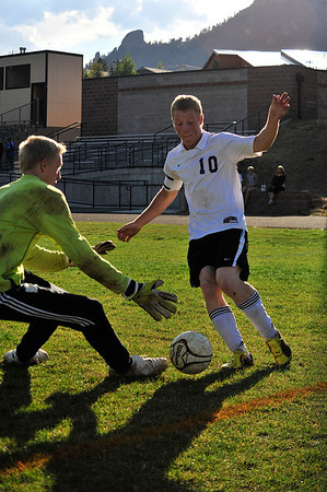 Walt Hester | Trail Gazette<br /> Cain Bratrud, the Bobcats' captain, goes one-on-one against the Bennett Tigers' goalkeeper earlier this month. Bratrud has been the leader in word and deed throughout the 'Cats' 2011 campaign.