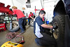 "Walt Hester | Trail Gazette<br /> Big ""O"" tire employees, from left, Keith Lanting, Jason Gray and Eric Fernandez work furiously on Tuesday to mount snow tires for customers ahead of Werdnesday's predicted storm. Estes Park could see as much as 15 inches of snow out of the first big winter storm."