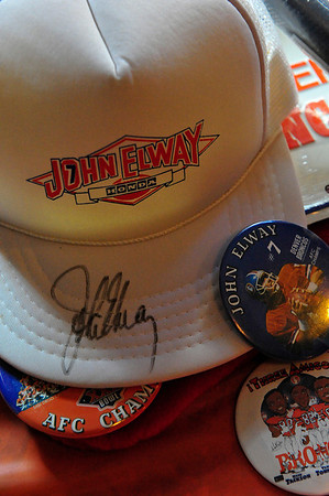 Walt Hester | Trail Gazette<br /> One of the many silent auction items included a hat signed by John Elway. The legendary Broncos quarterback led the team to two consecutive Super Bowl wins before retiring in 1999.