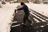 Walt Hester | Trail Gazette<br /> Shane Cave of Estes Park finishes pushing 14-inch-deep snow off of a driveway along Stanley Avenue on Wednesday. The wet, heavy snow had residents and road crews up early to make road, sidewalks and driveways passable.