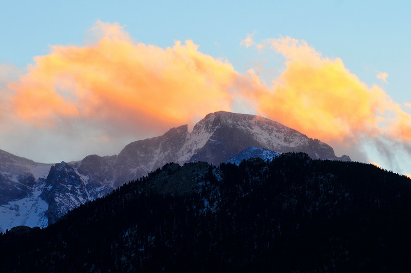 Walt Hester | Trail-Gazette<br /> The last rays of sunset paint clouds above Longs Peak on Wednesday.
