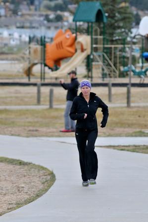 Walt Hester   Trail-Gazette<br /> Local runner Shelly Doggett runs along the Lake Estes Trail on Sunday.