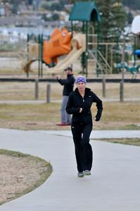 Walt Hester | Trail-Gazette Local runner Shelly Doggett runs along the Lake Estes Trail on Sunday.