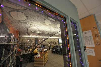Walt Hester | Trail-Gazette Halloween flair is displayed in the Estes Park Middle School library window on Wednesday. Schools enjoyed costume contests and decorations this week.