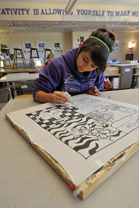 Walt Hester | Trail-Gazette Middle-schooler Denise Palacios, 13, works on a black and white project in her art class on Wednesday.