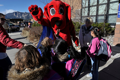 Walt Hester | Trail-Gazette Elementary school students mob Clifford the Big Red Dog at the school on Wednesday. The famous children's literary figure was at the school to celebrate the annual Scholastic Bookfair.