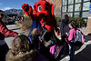 Walt Hester | Trail-Gazette<br /> Elementary school students mob Clifford the Big Red Dog at the school on Wednesday. The famous children's literary figure was at the school to celebrate the annual Scholastic Bookfair.