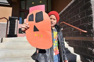 Jesse Trevino, 5, proudly displays his paper jack-o-lantern at the Estes Park Elementary School on Wednesday. As Halloween nears, art turns fun and a little creepy.