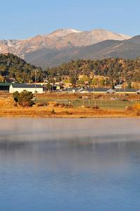 Walt Hester | Trail-Gazette Mist on Lake Estes causes a light sheen on the water on Sunday.