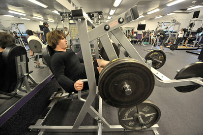 Walt Hester | Trail-Gazette Bobcat football player Ben Addison works the leg press mechine during the team's workout on Wednesday. The boys had already practiced outside before hitting the weights.