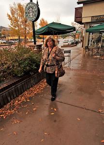 Walt Hester | Trail-Gazette Pat Leikawn of Manhattan, Kans. walks through damp leaves along Elkhorn Avenue on Friday.