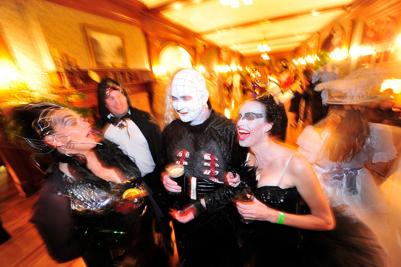 "Walt Hester | Trail Gazette<br /> Costumed revelers enjoy the Shining Ball at the Stanley Hotel on Saturday. The hotel is the legendary birthplace to Stephen King's horror classics ""Cujo"" and, of course, ""The Shining."""
