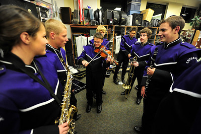Walt Hester | Trail Gazette Douglas Klink entertains his band mates befor the Estes Park High School Bands' indoor concert on Tuesday night. The band recently placed 4th at the state marching band competition.